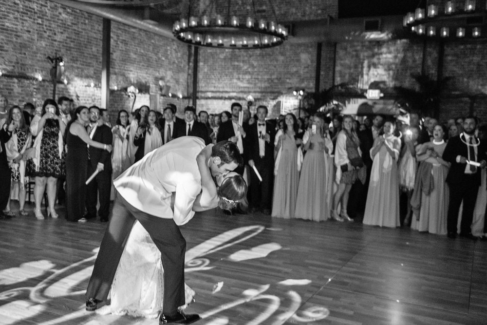 Groom dips bride for a romantic kiss after the first dance; Sylvie Gil Photography