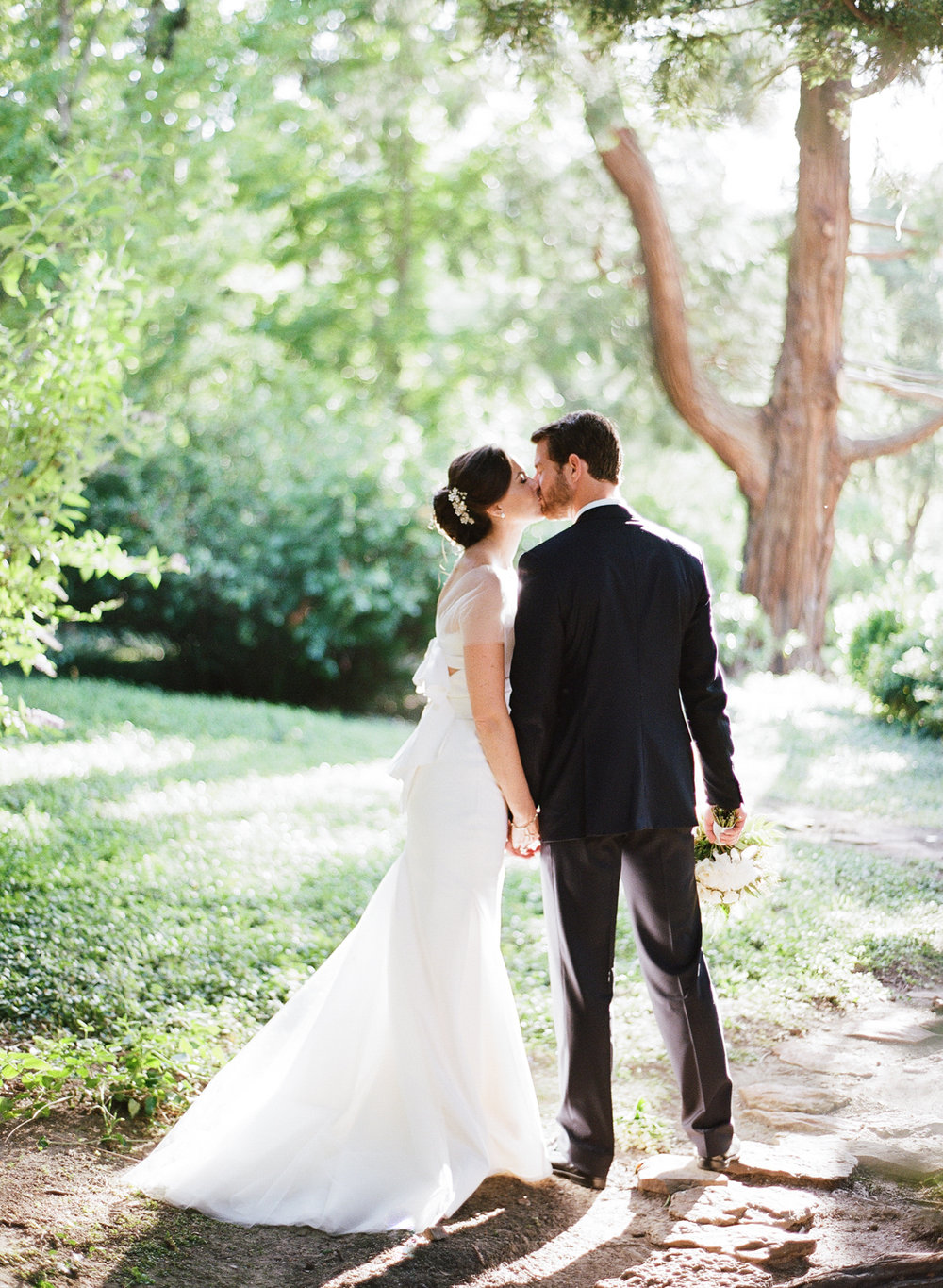 Bride and groom kiss on private estate in Woodside, California; Sylvie Gil Photography