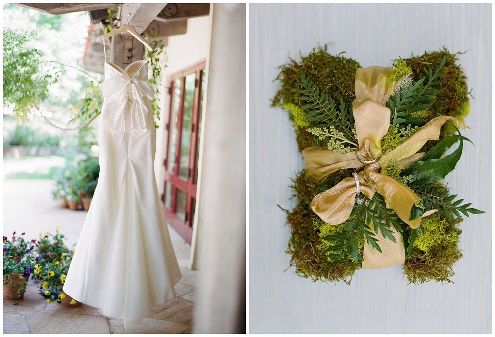 Contemporary Vera Wang gown and wedding rings tied up on a bed of moss; Sylvie Gil Photography