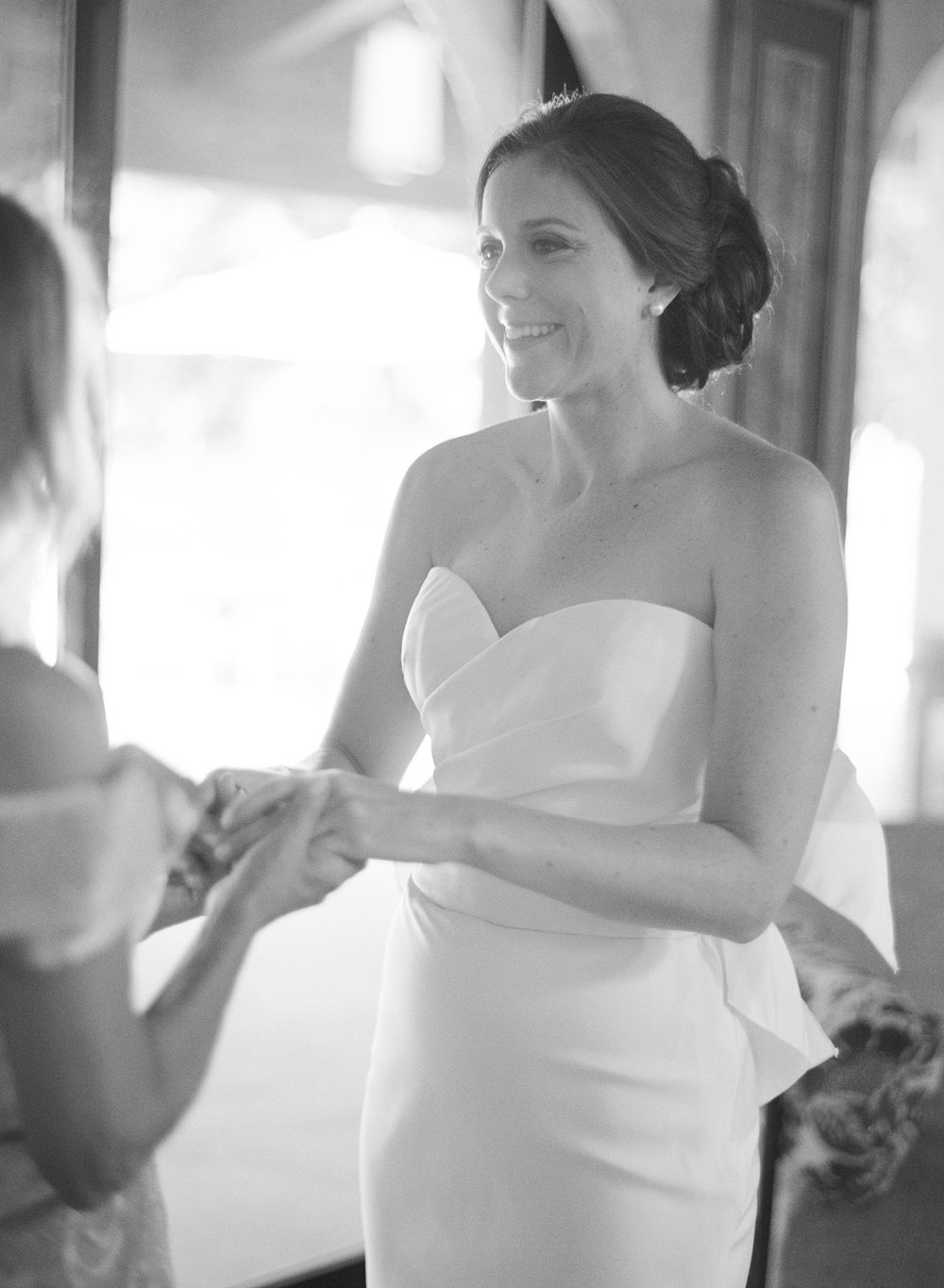 Bride getting ready in her Vera Wang wedding gown; Sylvie Gil Photography