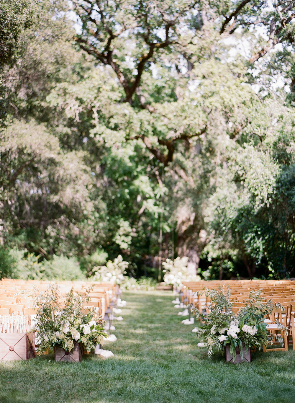 Outdoor ceremony space under oak trees in Woodside, California; Sylvie Gil Photography