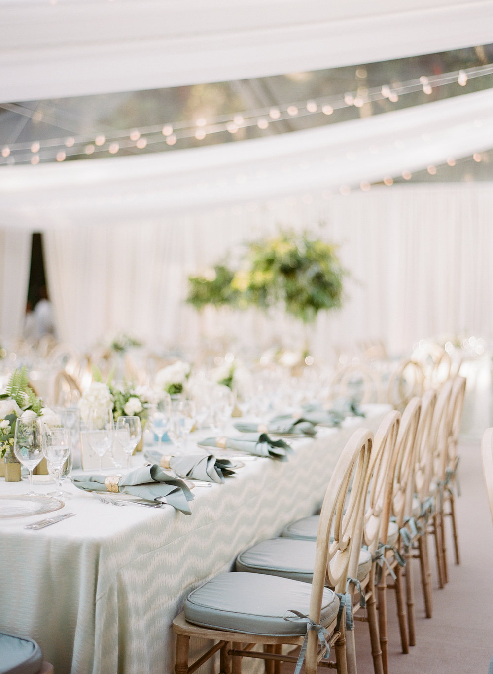 A mix of long and round reception tables with chevron tablecloths and dark teal accents; Sylvie Gil Photography
