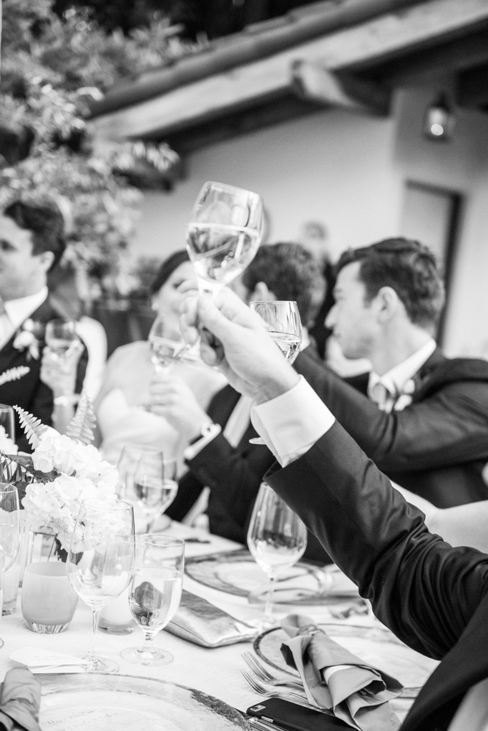 Guests raise their glasses for a toast during the outdoor reception in Woodside, California; Sylvie Gil Photography