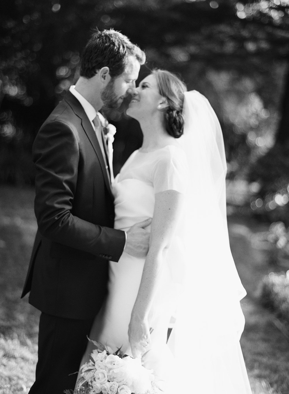 Bride and groom kiss after the ceremony, bride wears a stunning contemporary Vera Wang gown; Sylvie Gil Photography