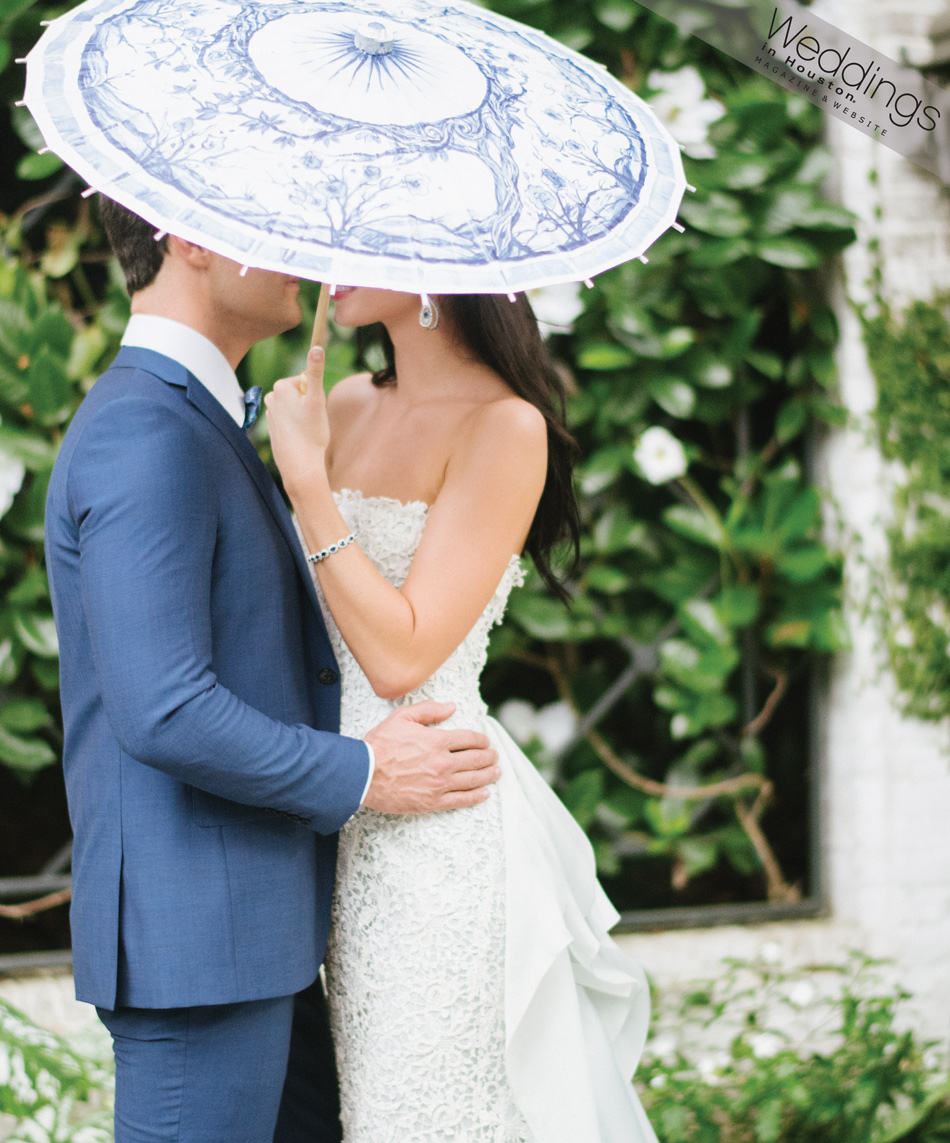 Bride and groom with blue china parasol in 'A Southern Fete', featured in Weddings in Houston; Sylvie Gil Photography