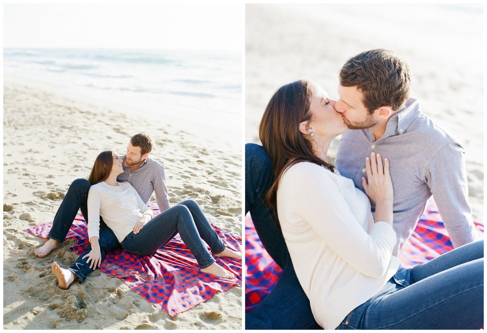 Couple on blanket at beach for engagement session; Sylvie Gil Photography