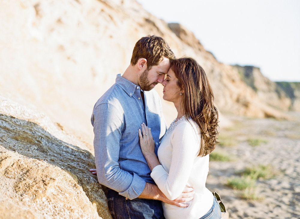 Couple shares a moment during romantic engagement session; Sylvie Gil Photography