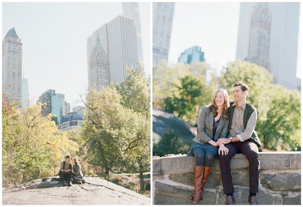 Couple sits on a bridge in Central Park, New York City, during an engagement session; Sylvie Gil Photography
