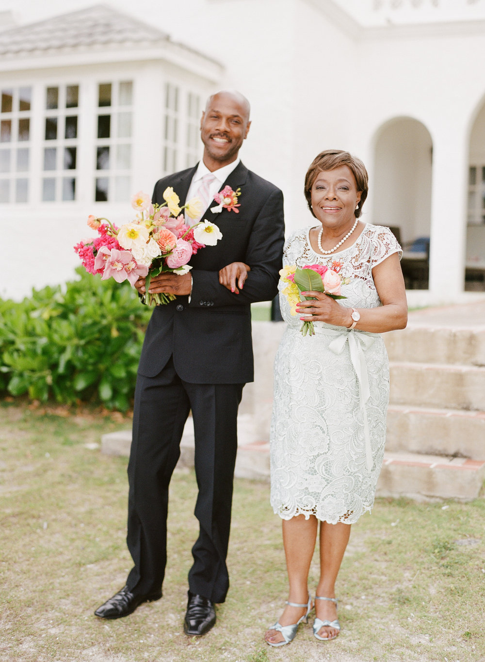 Bride's mother and brother walked her down the aisle at the Montego Bay, Jamaica ceremony; Sylvie Gil Photography