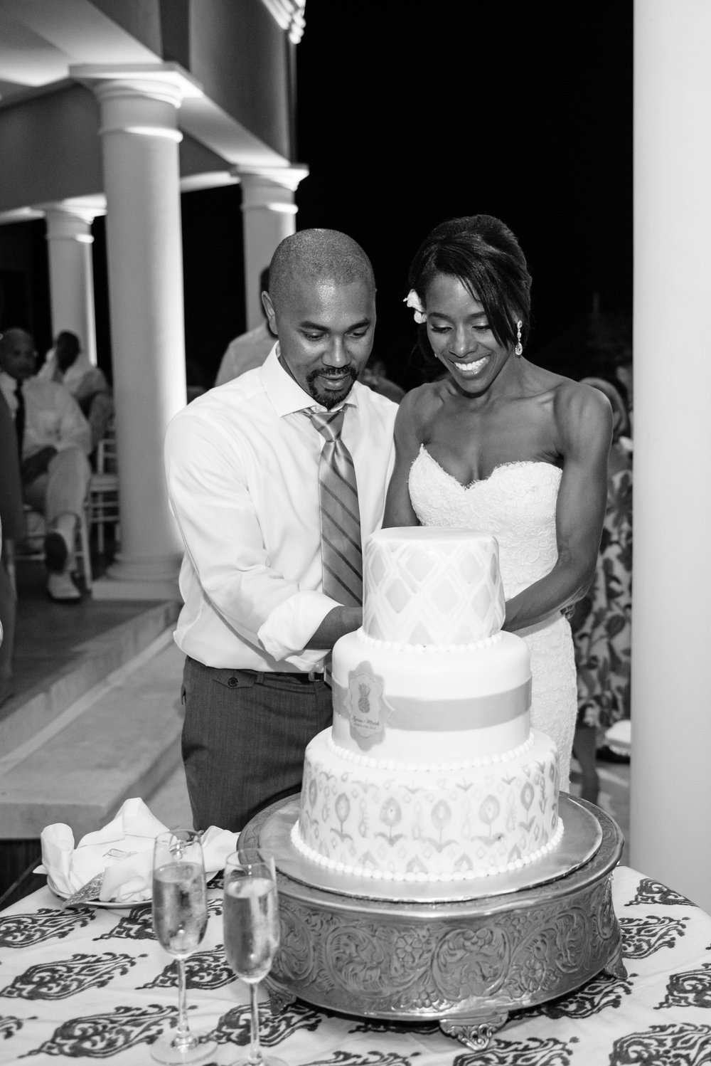 Bride and groom cut their three tier ikat cake at the Montego Bay, Jamaica reception; Sylvie Gil Photography
