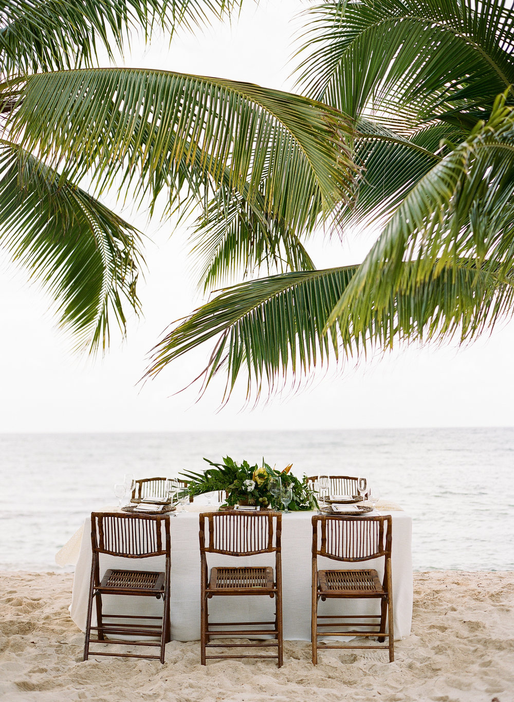 Dark wicker chairs for beach reception table in Montego Bay, Jamaica; Sylvie Gil Photography