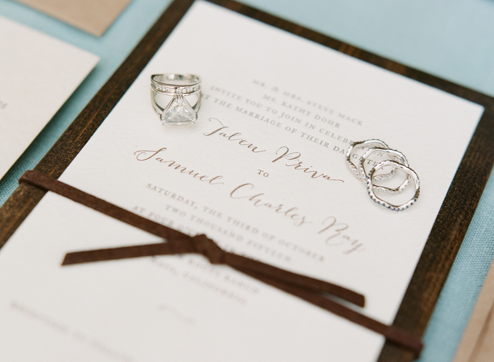 Gorgeous wood-themed invitations and Tali's unique triangular prism ring; photoby Sylvie Gil