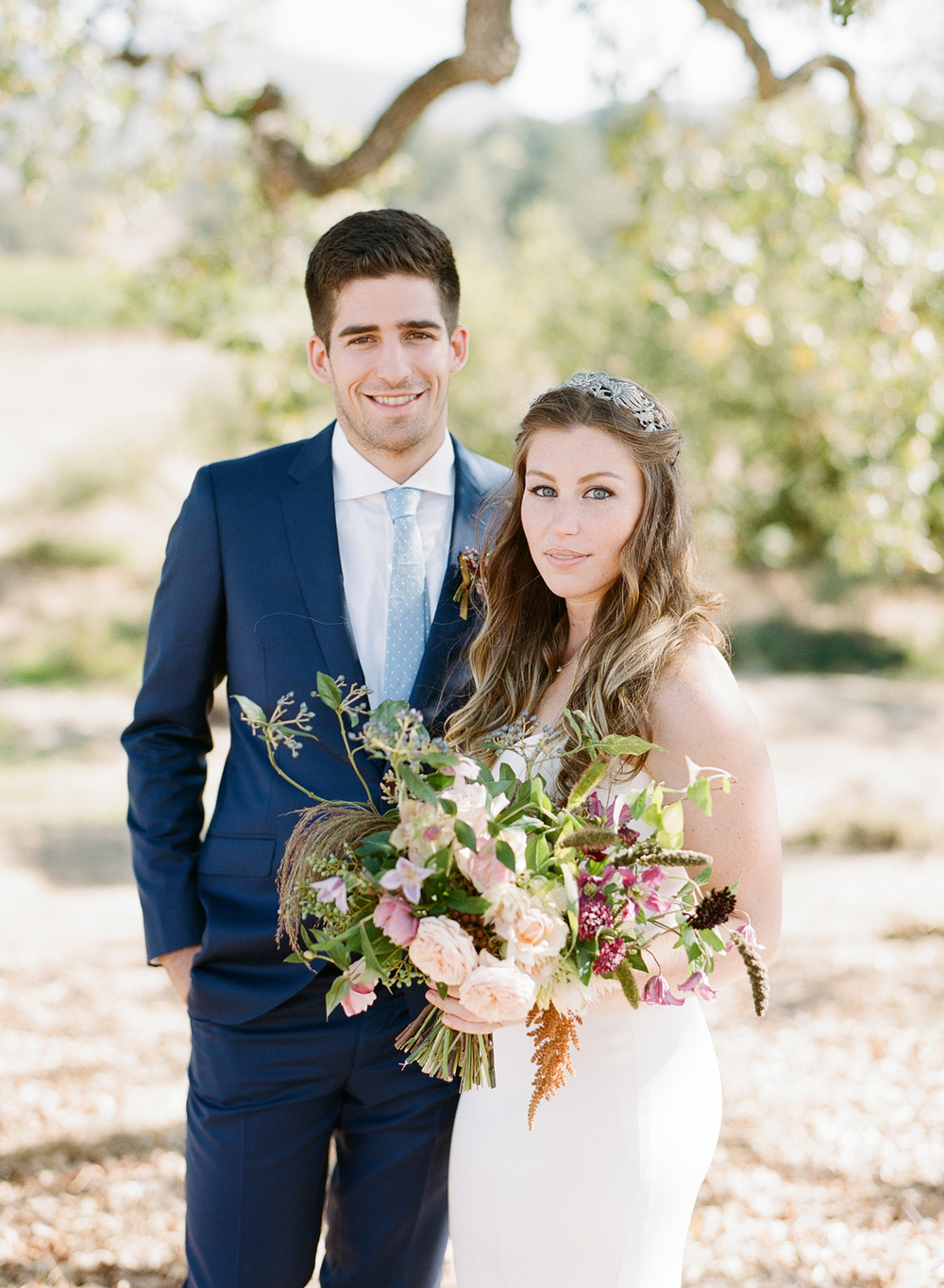 In a couple shoot before the wedding, Tali and Sam pose in the Napa countryside at a private venue; photo by Sylvie Gil
