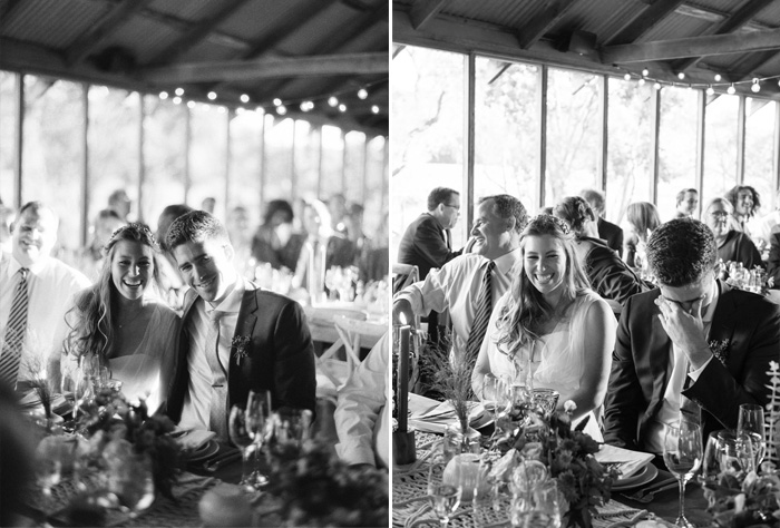 A sweet moment as the couple shares a laugh during their barn reception; photo by Sylvie Gil