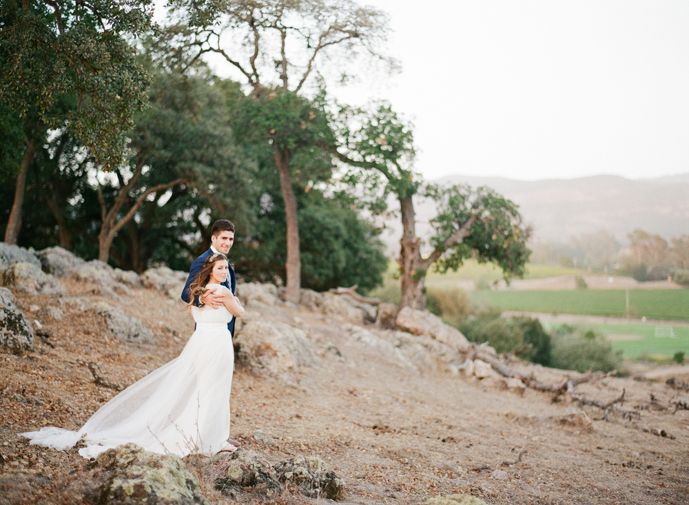 In the glowing afternoon light, the couple looks out over Napa countryside during a couple session with Sylvie Gil
