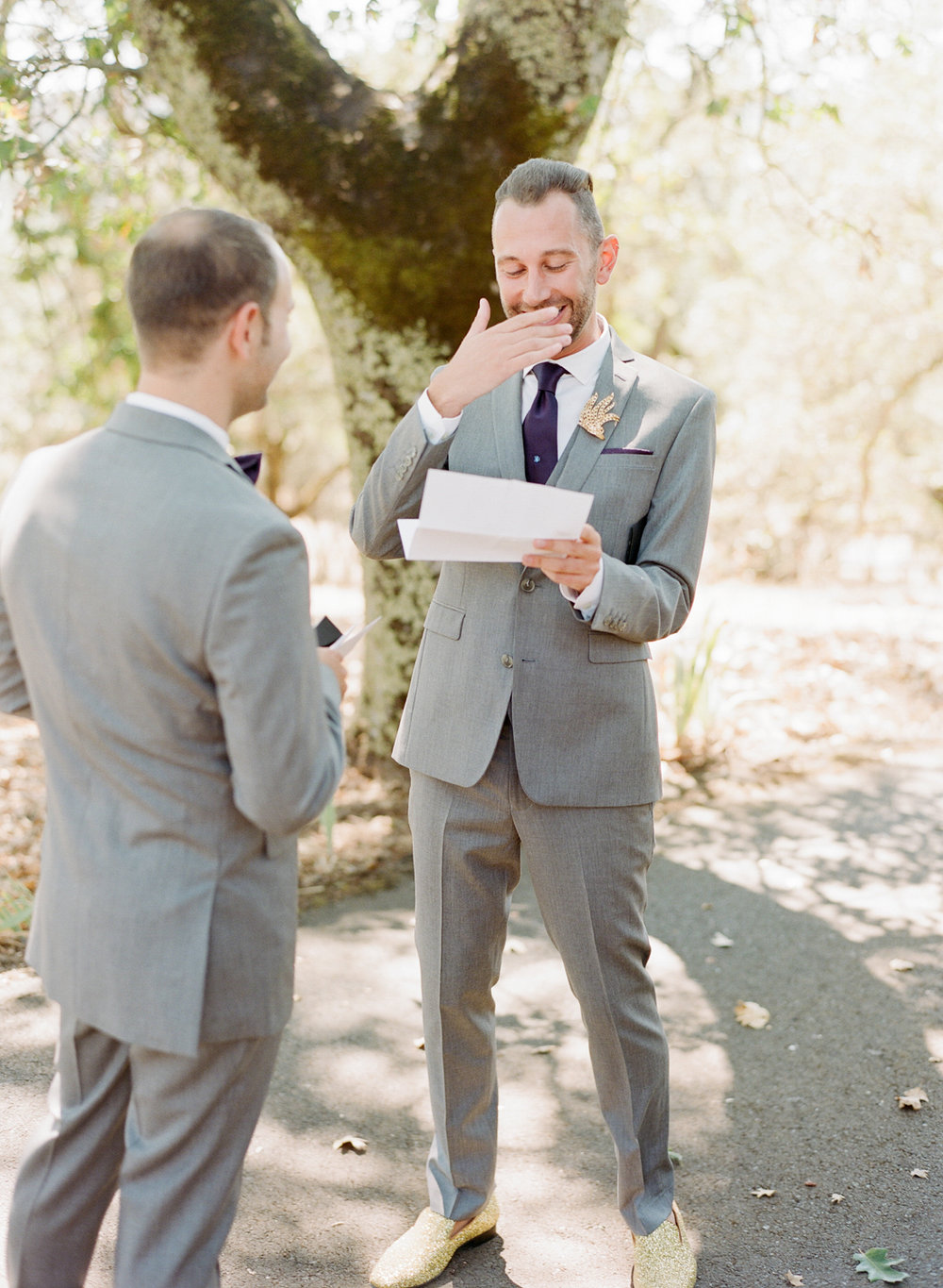 Grooms read each others' letters before the wedding ceremony; Sylvie Gil Photography