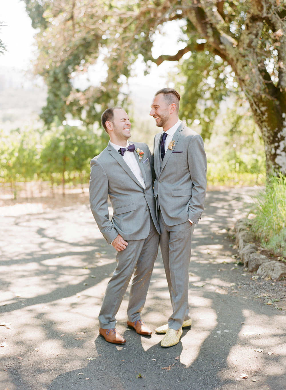 Cute gay couple share a laugh before their wedding ceremony at Kunde Winery; Sylvie Gil Photography
