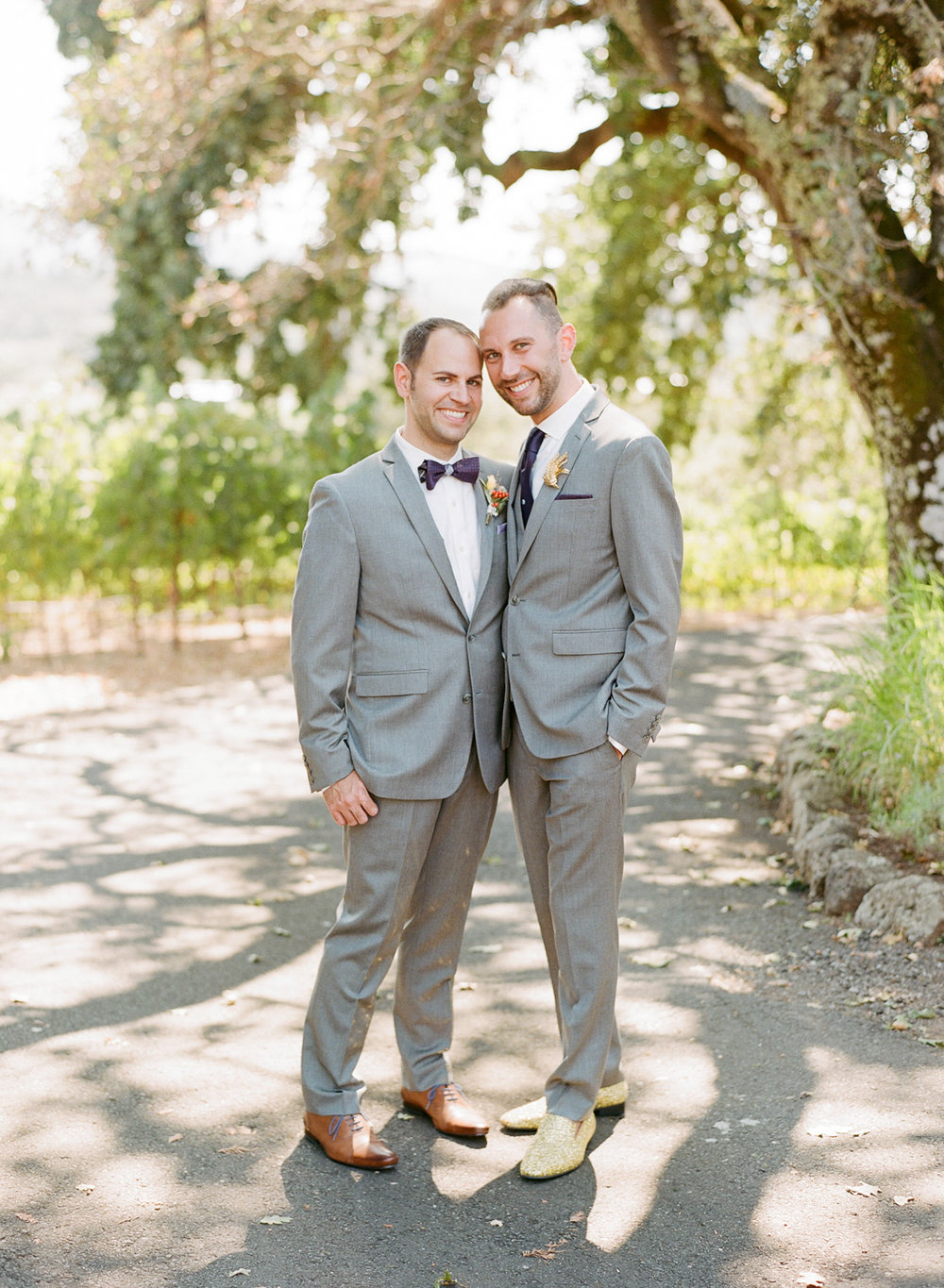 Grooms pose for the camera before their Kunde Family Winery wedding; Sylvie Gil Photography