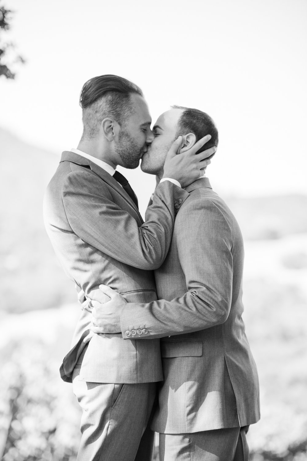 Sweet gay couple exchanges vows and shares their first kiss at their Napa Valley wedding ceremony; Sylvie Gil Photography