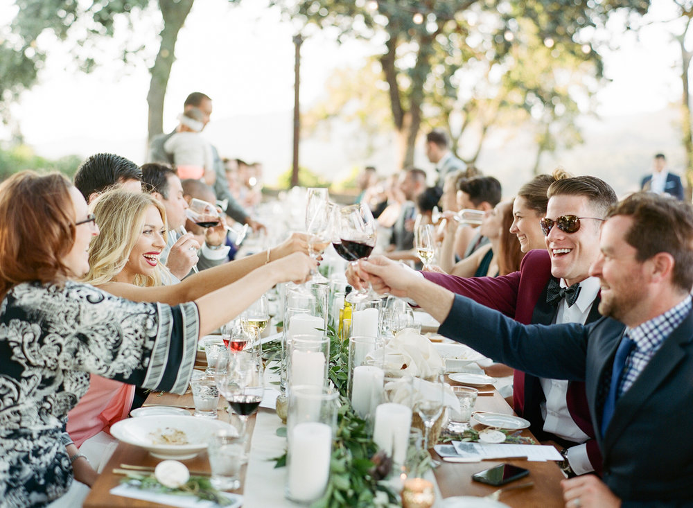 Guests toast the new couple at the outdoor wedding reception held at Kunde Family Winery in Napa Valley; Sylvie Gil Photography