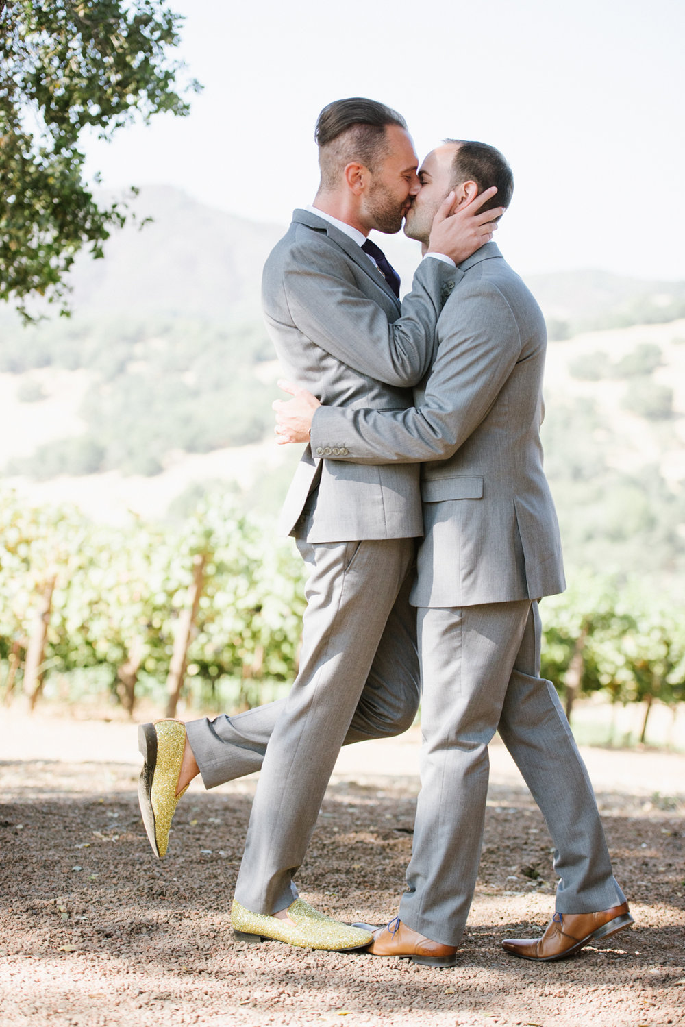 The adorable couple shares a kiss during their Kunde Winery, Napa Valley wedding ceremony; Sylvie Gil Photography