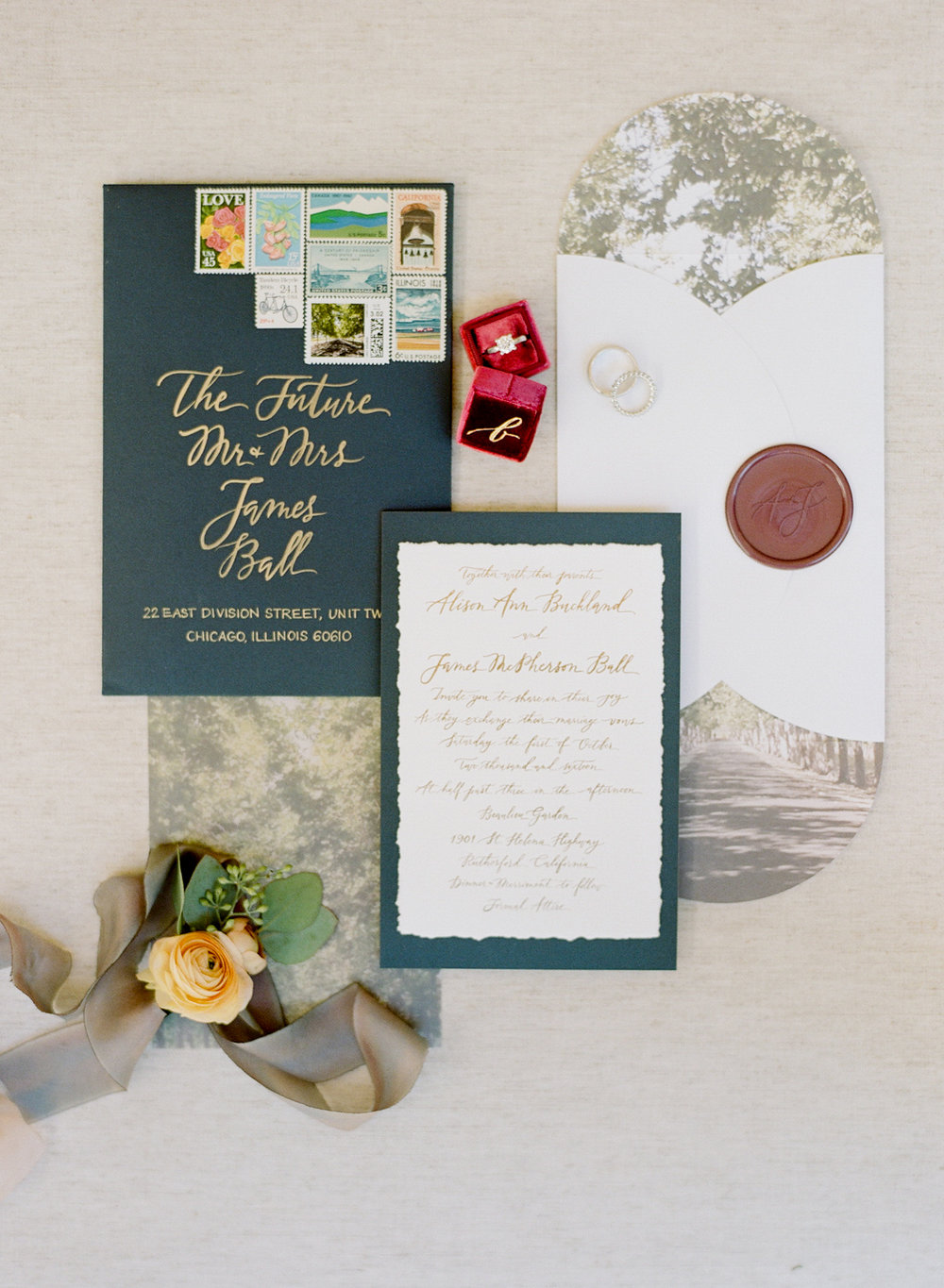 Navy and gold invitation suite with a custom seal with the couple's initials; Sylvie Gil Photography