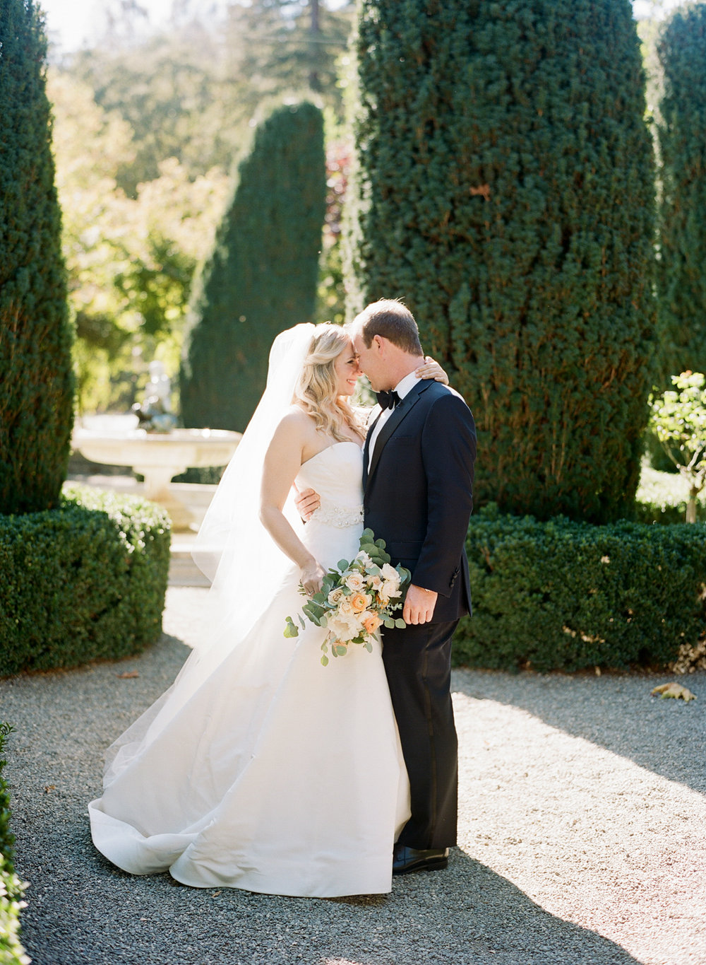 Bride and groom share a smile during their first look in Beaulieu Gardens; Sylvie Gil Photography