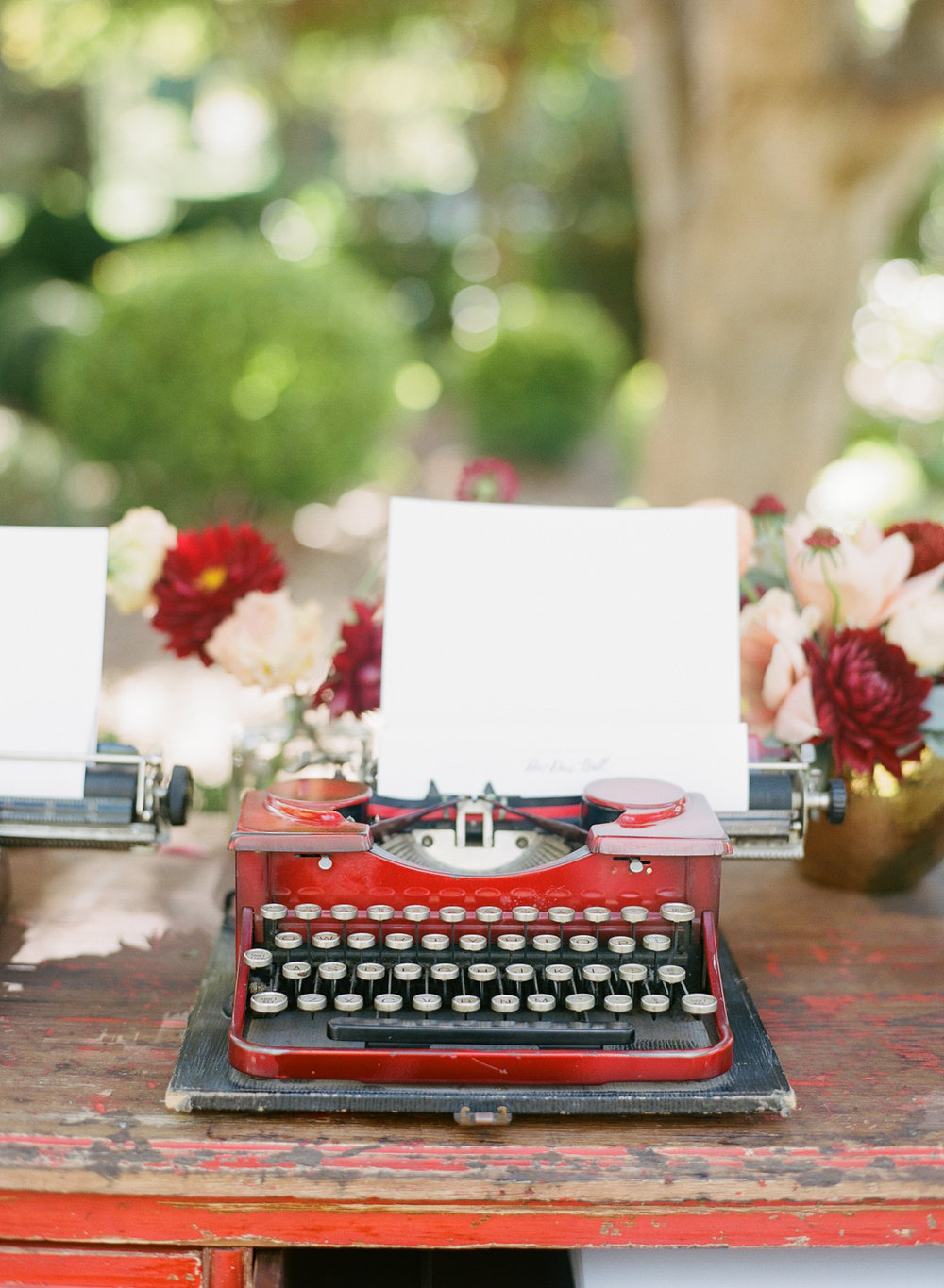 Vintage typewriters for guests to write notes to the couple before the ceremony; Sylvie Gil Photography