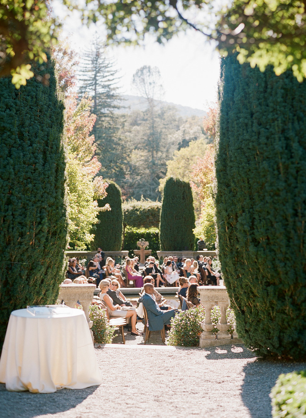 Guests seated by the fountain in Beaulieu Gardens, St. Helena; Sylvie Gil Photography