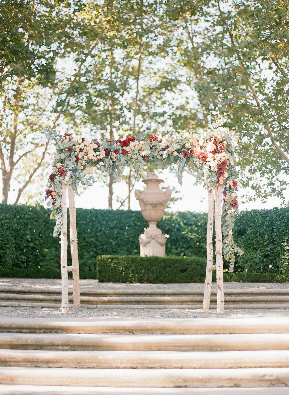 Floral arbor made up of birch stems and eucalyptus leaves in the Beaulieu Gardens ceremony space; Sylvie Gil Photography
