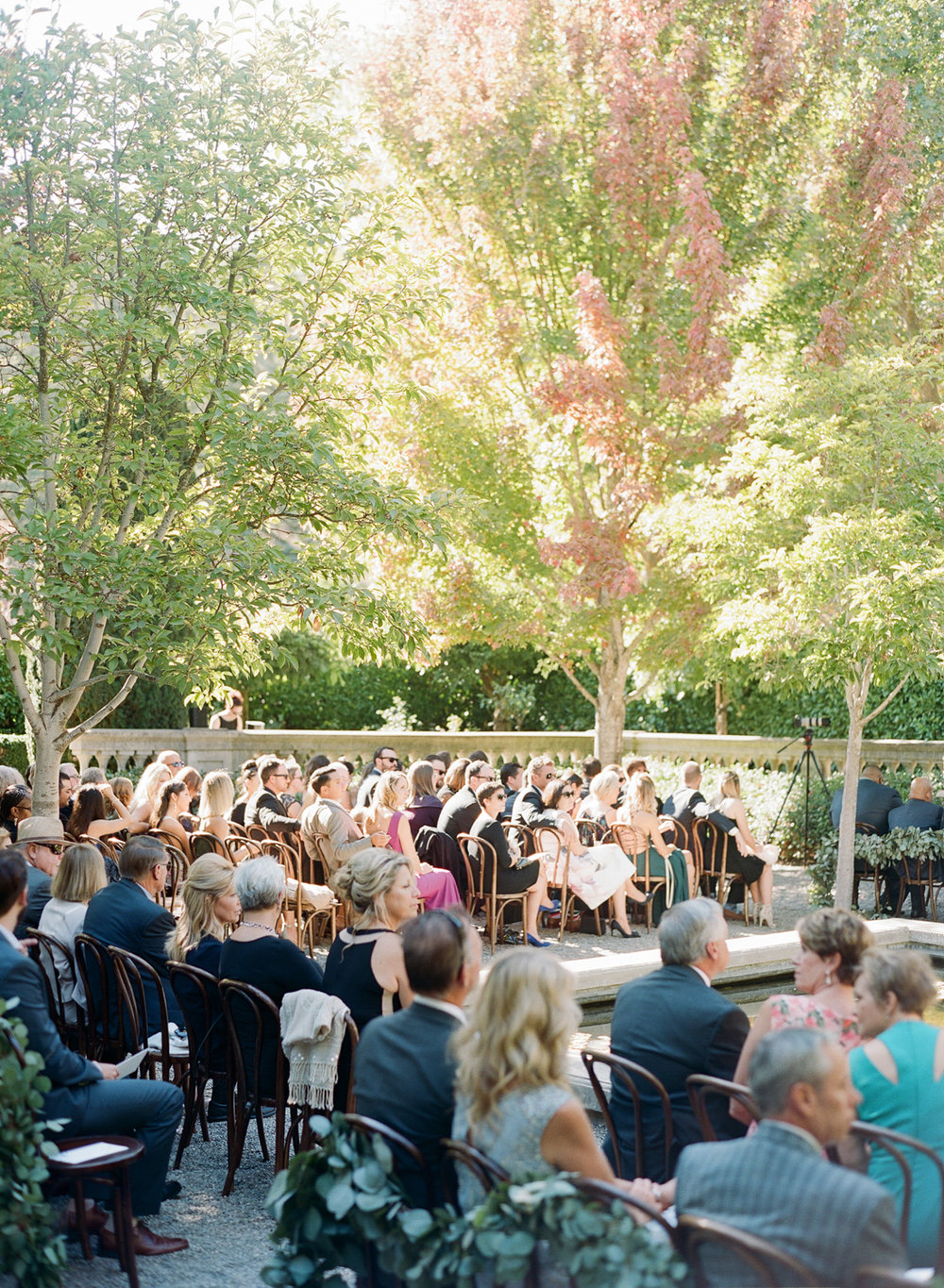 Guests seated in Beaulieu Gardens near the fountain before the wedding ceremony; Sylvie Gil Photography