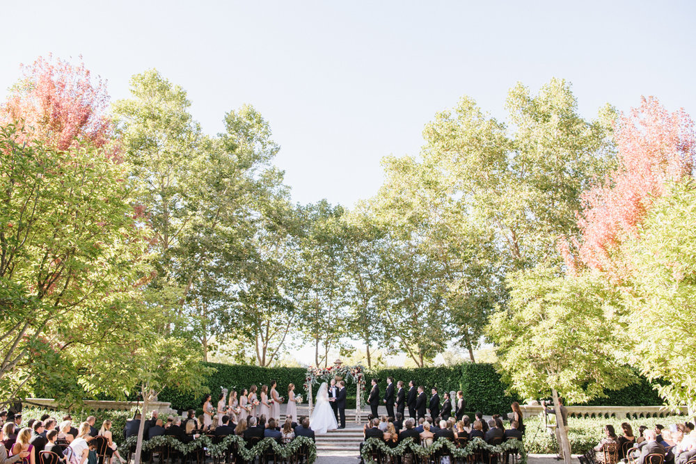 A wide shot of the wedding ceremony at Beaulieu Gardens in St. Helena, California; Sylvie Gil Photography