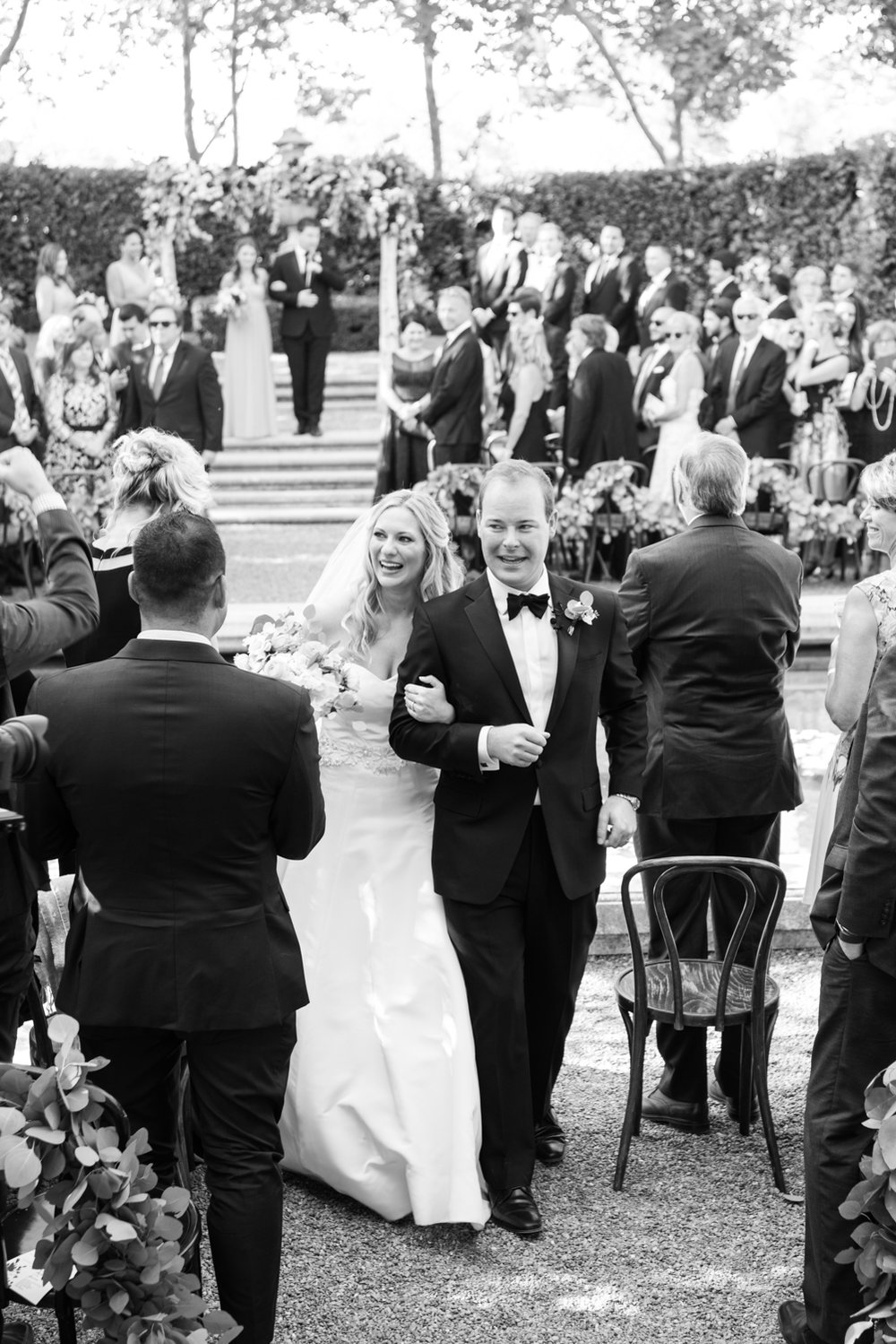 Bride and groom walk back down the aisle after the wedding ceremony, just married; Sylvie Gil Photography