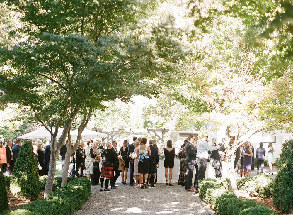 Guests mingle during the cocktail hour at a wedding in Beaulieu Gardens, St. Helena; Sylvie Gil Photography