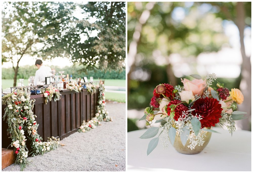 Reception bar draped with autumn floral garlands; Sylvie Gil Photography