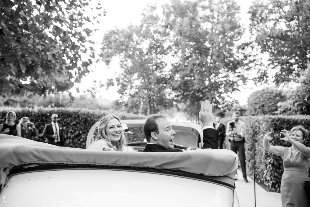 Bride and groom leave the reception in a vintage convertible getaway car after the ceremony at Beaulieu Gardens; Sylvie Gil Photography