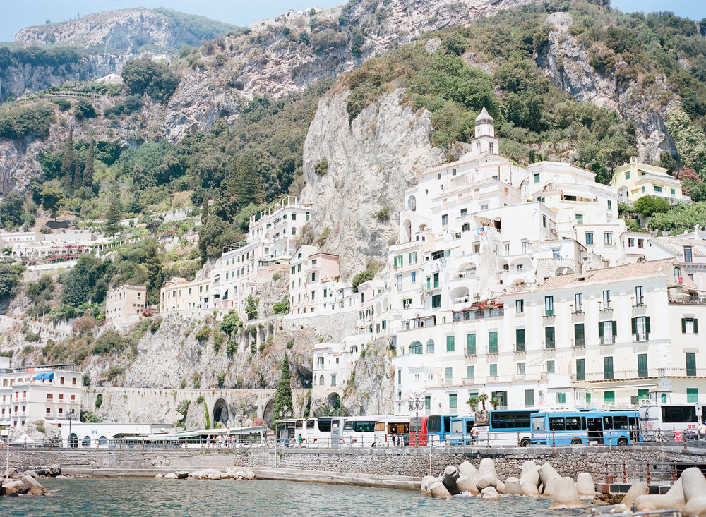 Villages cling to the edge of the Amalfi coast cliffs; Sylvie Gil Photography