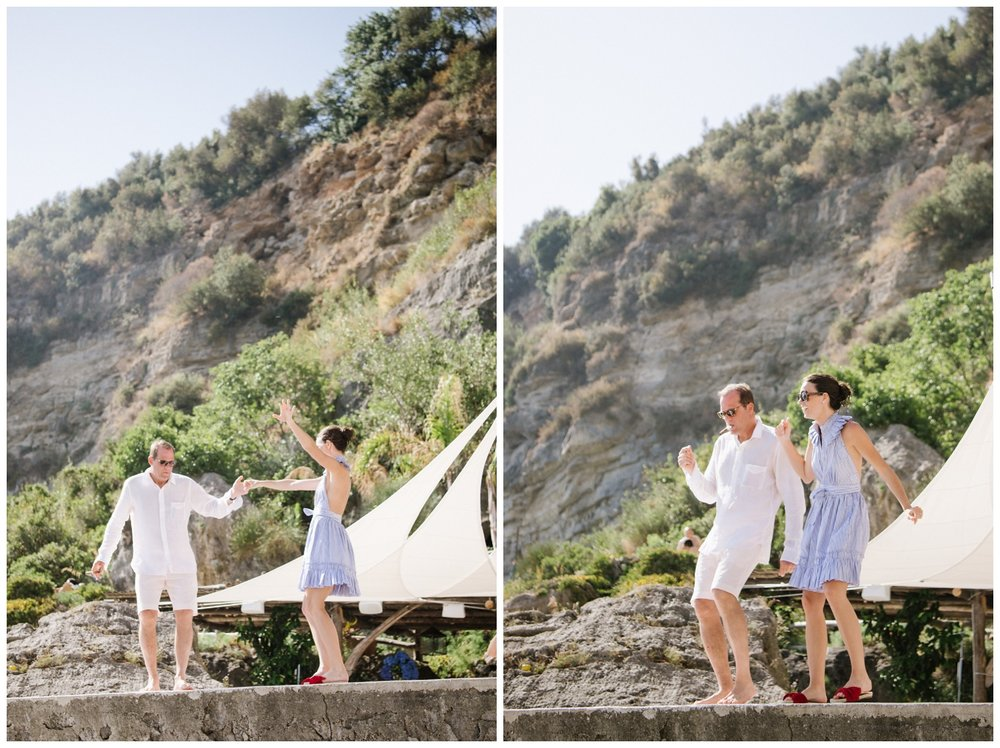 Bride and groom dance at the beach club in Positano, Amalfi Coast, in Italy; Sylvie Gil Photography