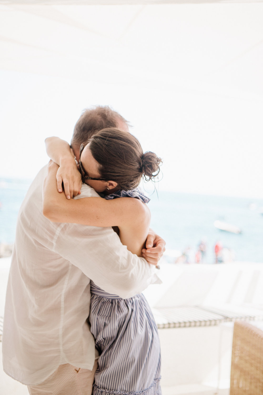 Bride and groom share a hug at their wedding brunch in Positano on the Amalfi Coast, in Italy; Sylvie Gil Photography