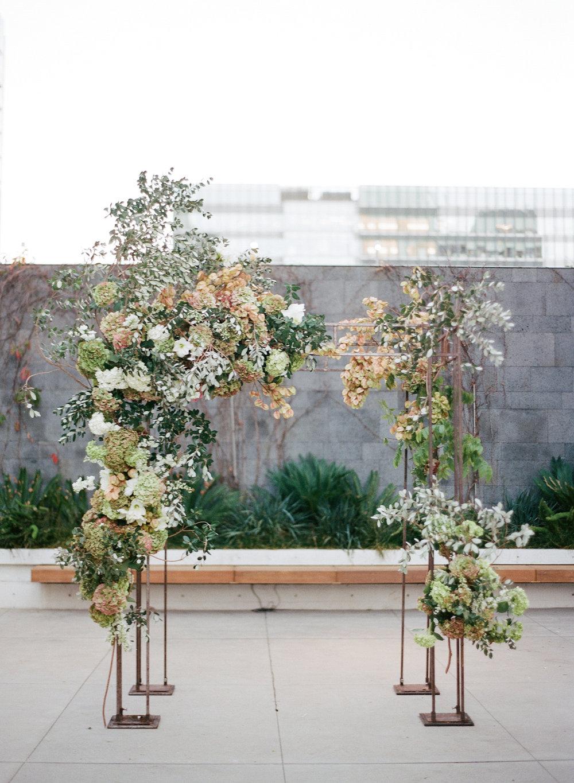Art deco wedding ceremony arbor with hydrangea and eucalyptus; Sylvie Gil Photography