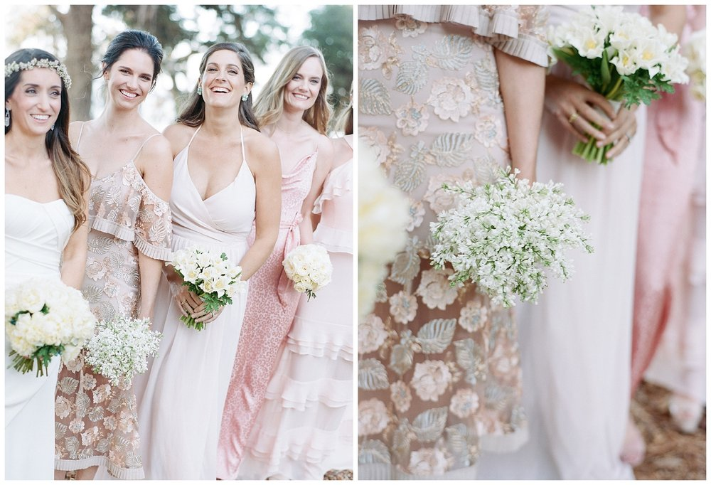 Bridesmaids in blush and pink gowns holding simple white bouquets; Sylvie Gil Photography