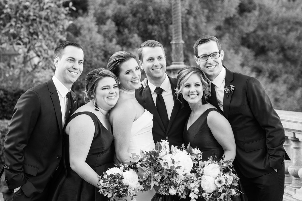 The bridal party leans in for a photograph at the Lyon Steps in San Francisco; Sylvie Gil Photography