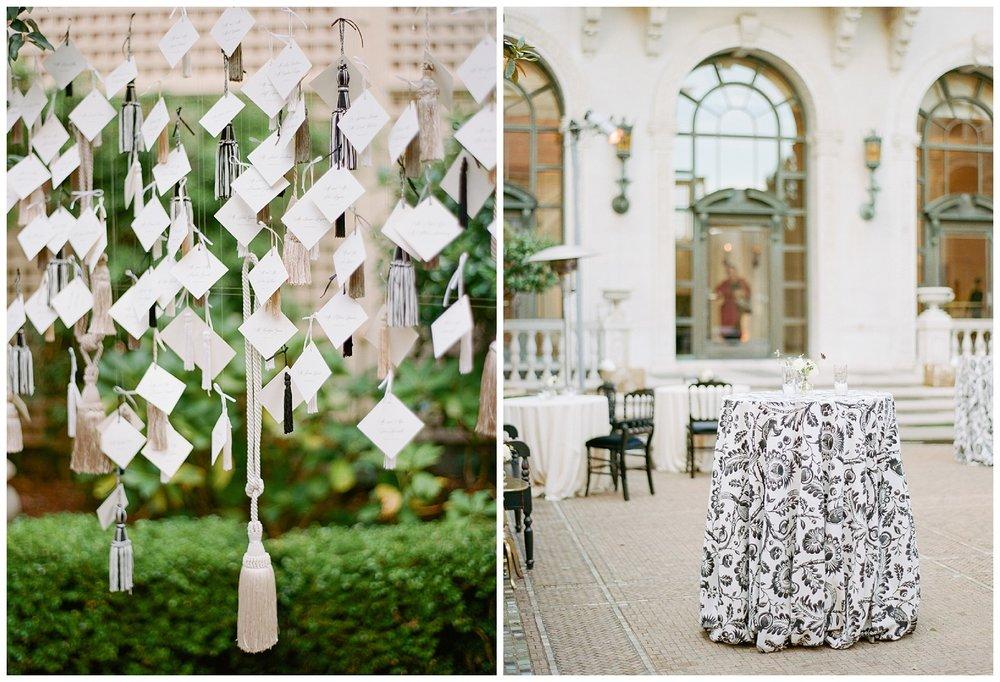 Name cards hang at the reception venue; Sylvie Gil Photography