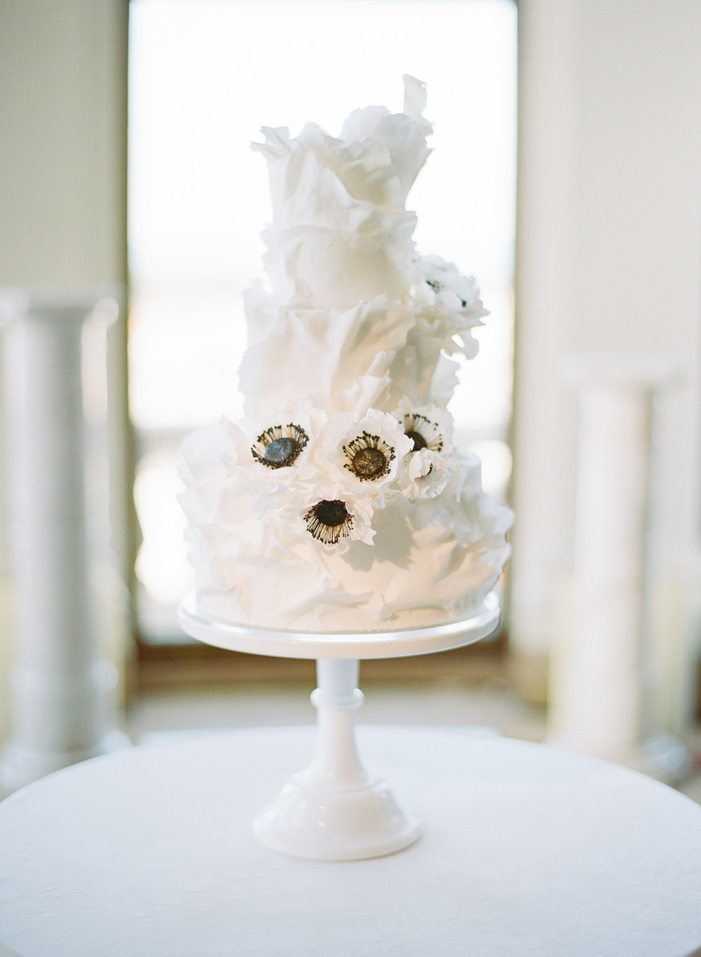 The white ruffled cake at the Flood Mansion, decorated with dogwoods; Sylvie Gil Photography