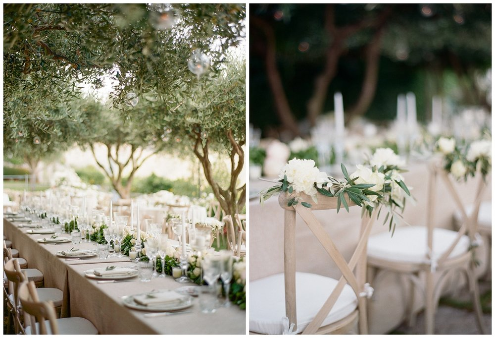 Reception table florals -white peonies and olive branches; Sylvie Gil Photography