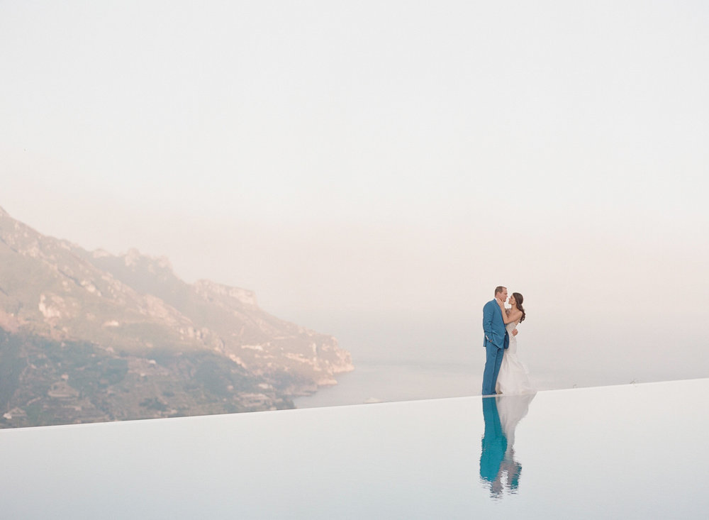 A portrait of the couple next to a pool in the cliffs of Ravello, Italy on the Amalfi Coast; Sylvie Gil Photography