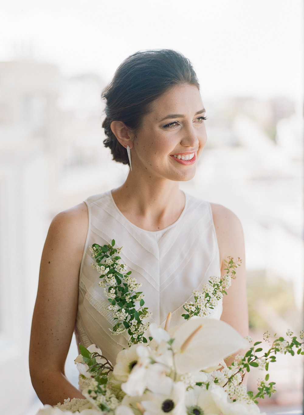 A portrait of the bride on her wedding day in San Francisco; Sylvie Gil Photography