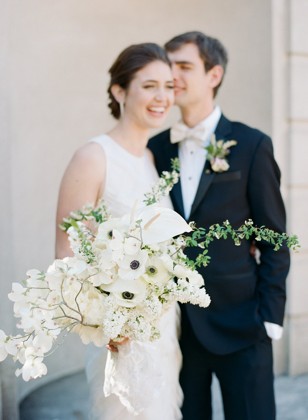 The bride and groom share a laugh before their San Francisco City Hall wedding; Sylvie Gil Photography