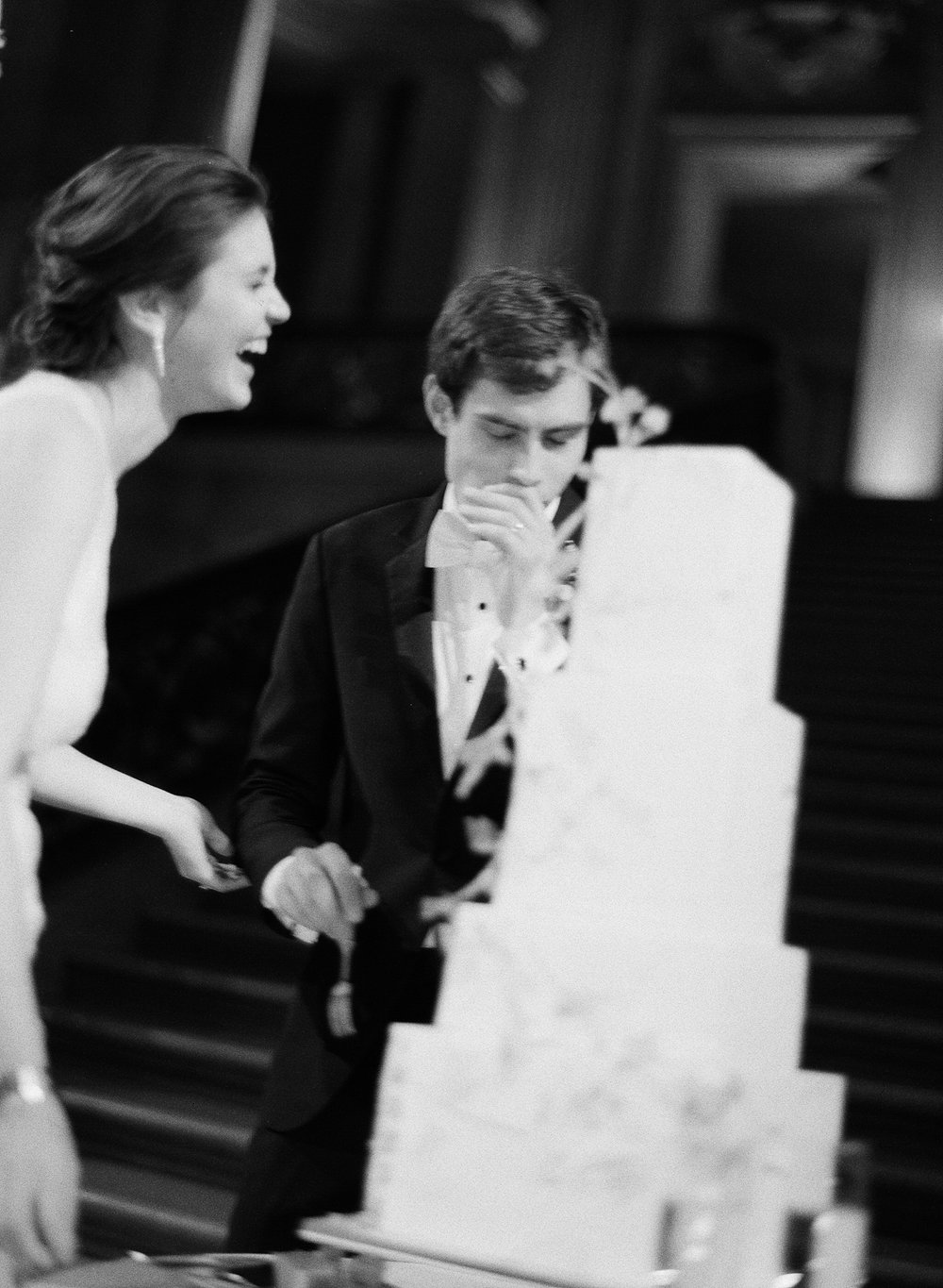 The couple shares a laugh during cake cutting; Sylvie Gil Photography