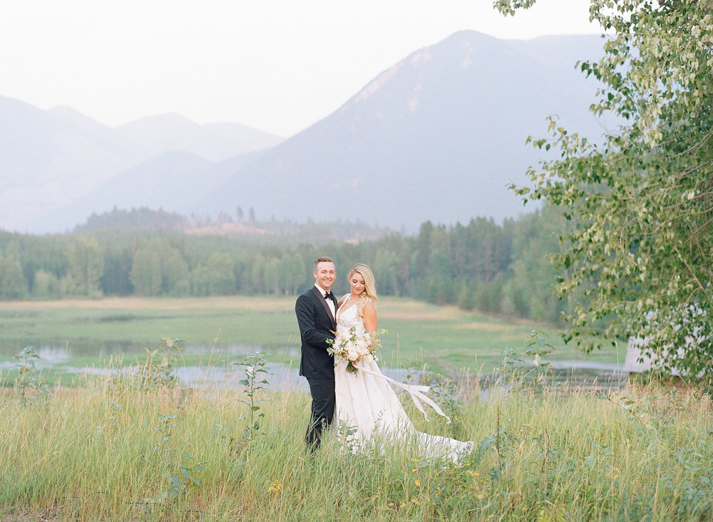 Couple portrait in the foothills of Glacier National Park in Montana; Sylvie Gil Photography